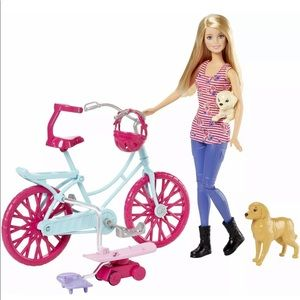 Barbie Spin 'N Ride Pups  Barbie and her pets go